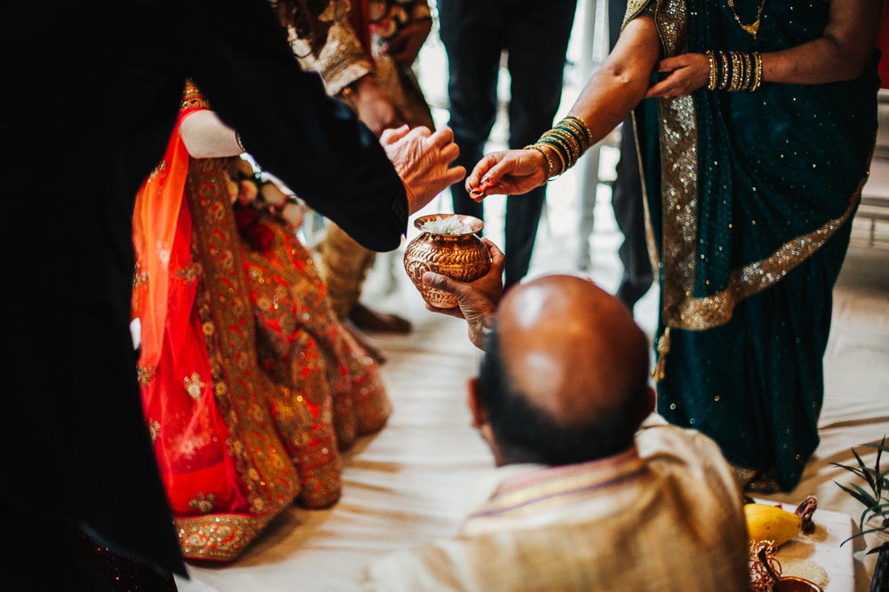 Styal Lodge Multicultural English Orange Pink Mandap Ceremony Traditional Ritual Aisle Bride Groom | Modern and Colorful Indian Wedding Emilie May Photography