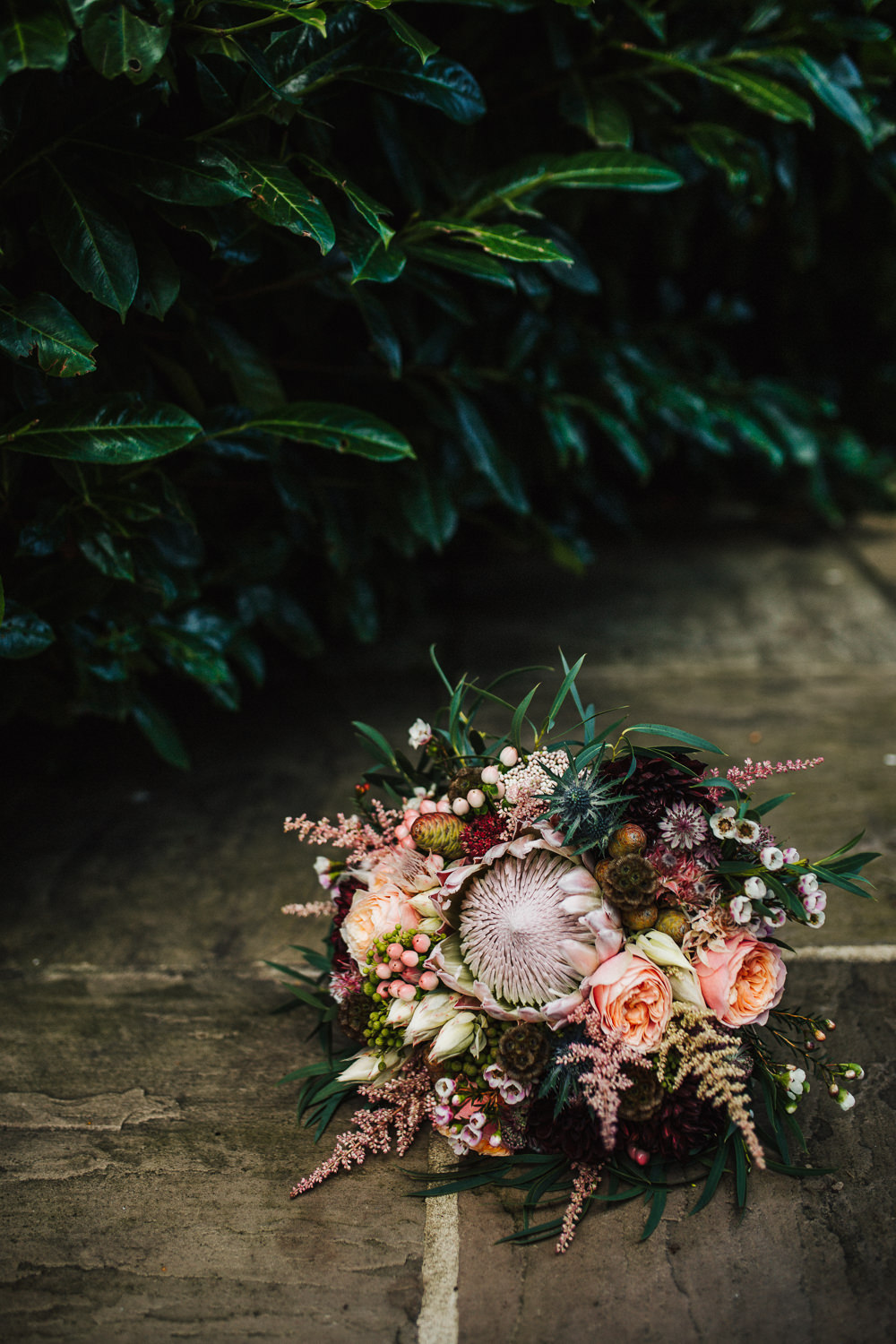 Styal Lodge Multicultural English Orange Pink Bride Bouquet Protea Wild Untamed | Modern and Colorful Indian Wedding Emilie May Photography
