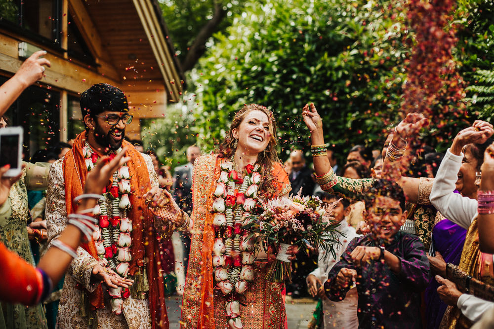 Styal Lodge Multicultural English Confetti Lengha Orange Pink Happy Bride Groom | Modern and Colorful Indian Wedding Emilie May Photography