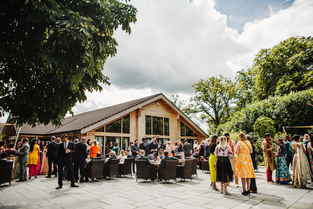 Styal Lodge Multicultural English Outdoor Reception Drinks | Modern and Colorful Indian Wedding Emilie May Photography