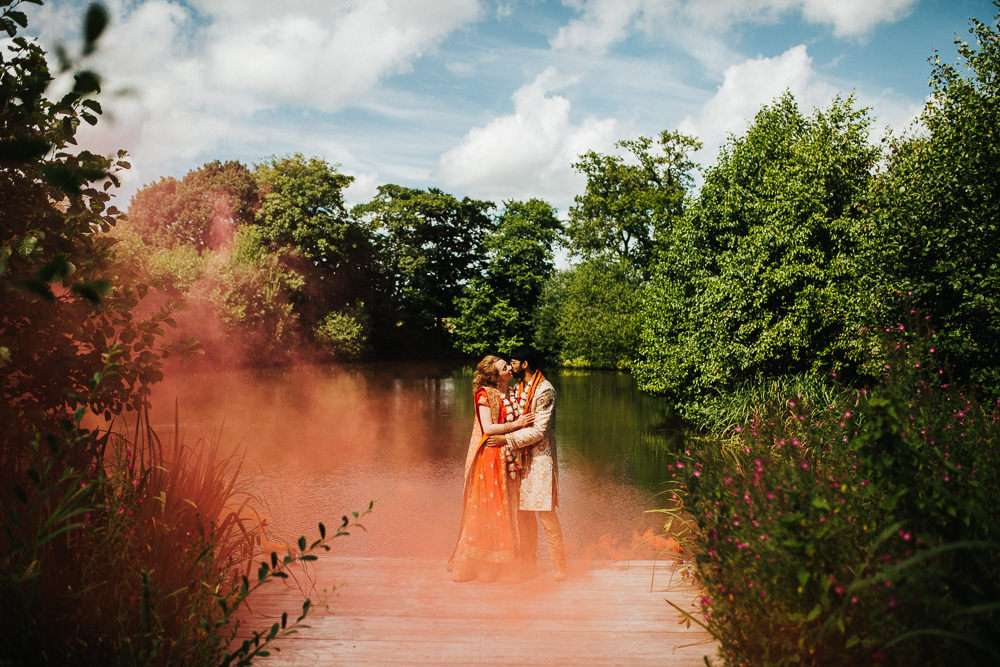 Styal Lodge Multicultural English Orange Smoke Bomb Bride Groom Forest Field | Modern and Colorful Indian Wedding Emilie May Photography