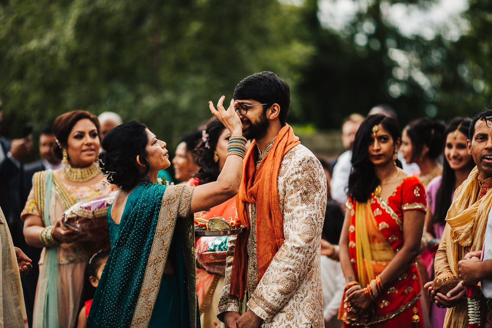 Styal Lodge Multicultural English Orange Pink Groom Bindi Henna | Modern and Colorful Indian Wedding Emilie May Photography