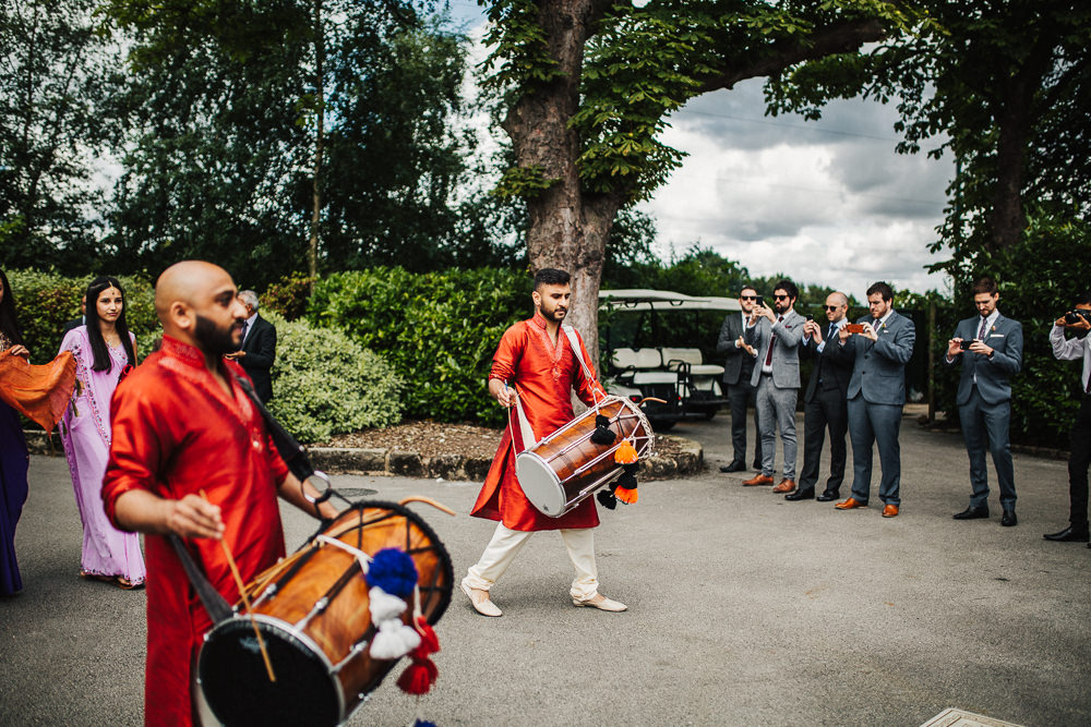 Styal Lodge Multicultural English Orange Pink Groom Entrance Dhol Drums | Modern and Colorful Indian Wedding Emilie May Photography