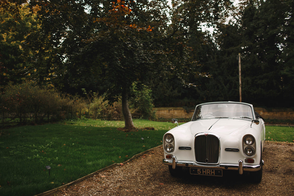 Cotswolds Royal Castle Summer Autumn Elegant Traditional White Classic Car | Sudeley Castle Wedding ARJ Photography