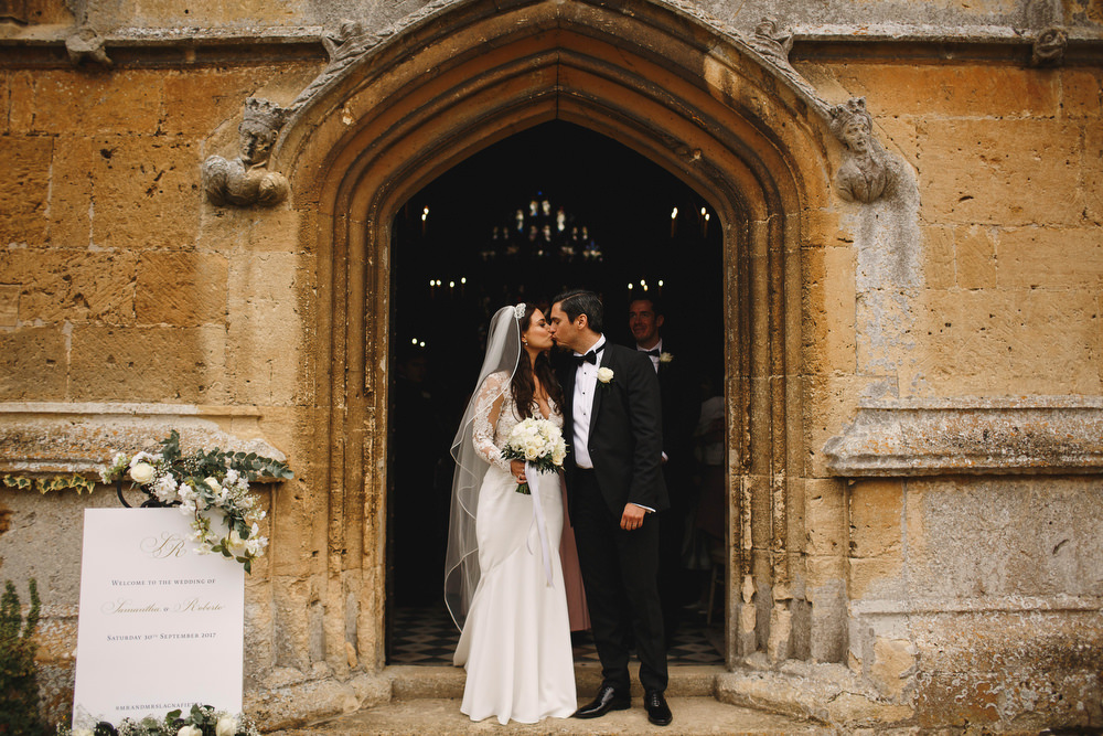Cotswolds Royal Castle Summer Autumn Traditional Classic Elegant Groom Bride Ceremony Church Kiss | Sudeley Castle Wedding ARJ Photography