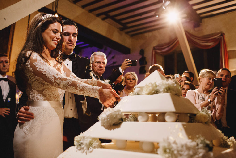 Cotswolds Royal Castle Summer Autumn Traditional Classic Elegant Bride Groom Dinner Reception Pyramid Cake Cutting | Sudeley Castle Wedding ARJ Photography