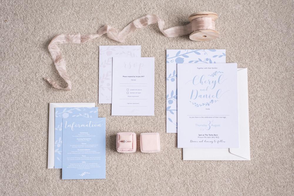 Stationery Flat Lay Invites Invitations Blue Calligraphy Silk Ribbon Velvet Ring Box Tythe Barn Priston Mill Wedding Eleanor Jane Photography