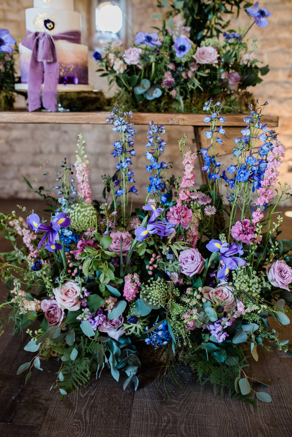 Iris Rose Delphiniums Backdrop Lilac Greenery Hoop Wreath Foliage Table Meadow Purple Ultra Violet Wedding Moon Gate Flower Arch Captured by Katrina Photography