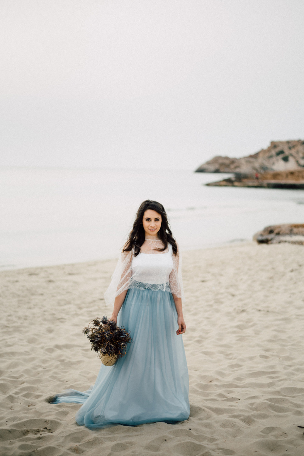 Outdoor Wild Nature Destination Spain Europe Coastal Styled Shoot Bride Blue Gown Lace | Blue Ibiza Elopement Ideas and Surprise Proposal Serena Genovese Photography