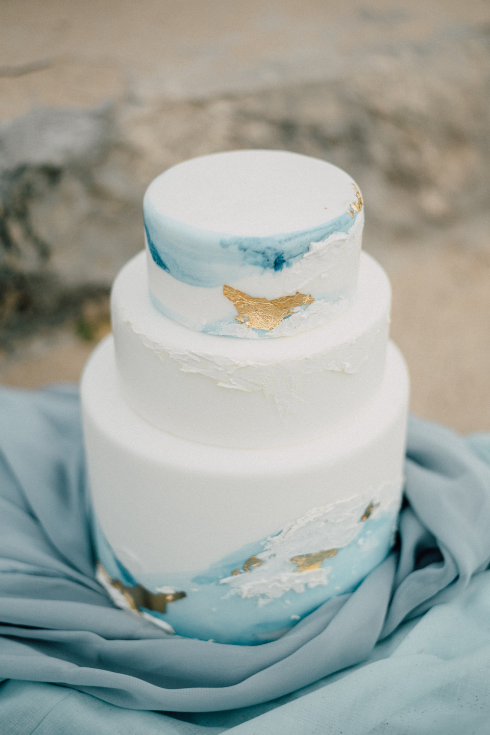 Outdoor Wild Nature Destination Spain Europe Beach Styled Shoot White Watercolor Brush Cake Gold Leaf | Blue Ibiza Elopement Ideas and Surprise Proposal Serena Genovese Photography