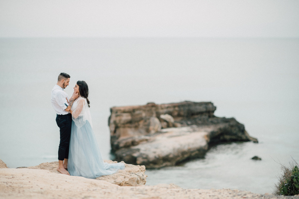 Outdoor Wild Nature Destination Spain Europe Beach Styled Shoot Groom Braces Bride Blue Gown Lace | Blue Ibiza Elopement Ideas and Surprise Proposal Serena Genovese Photography