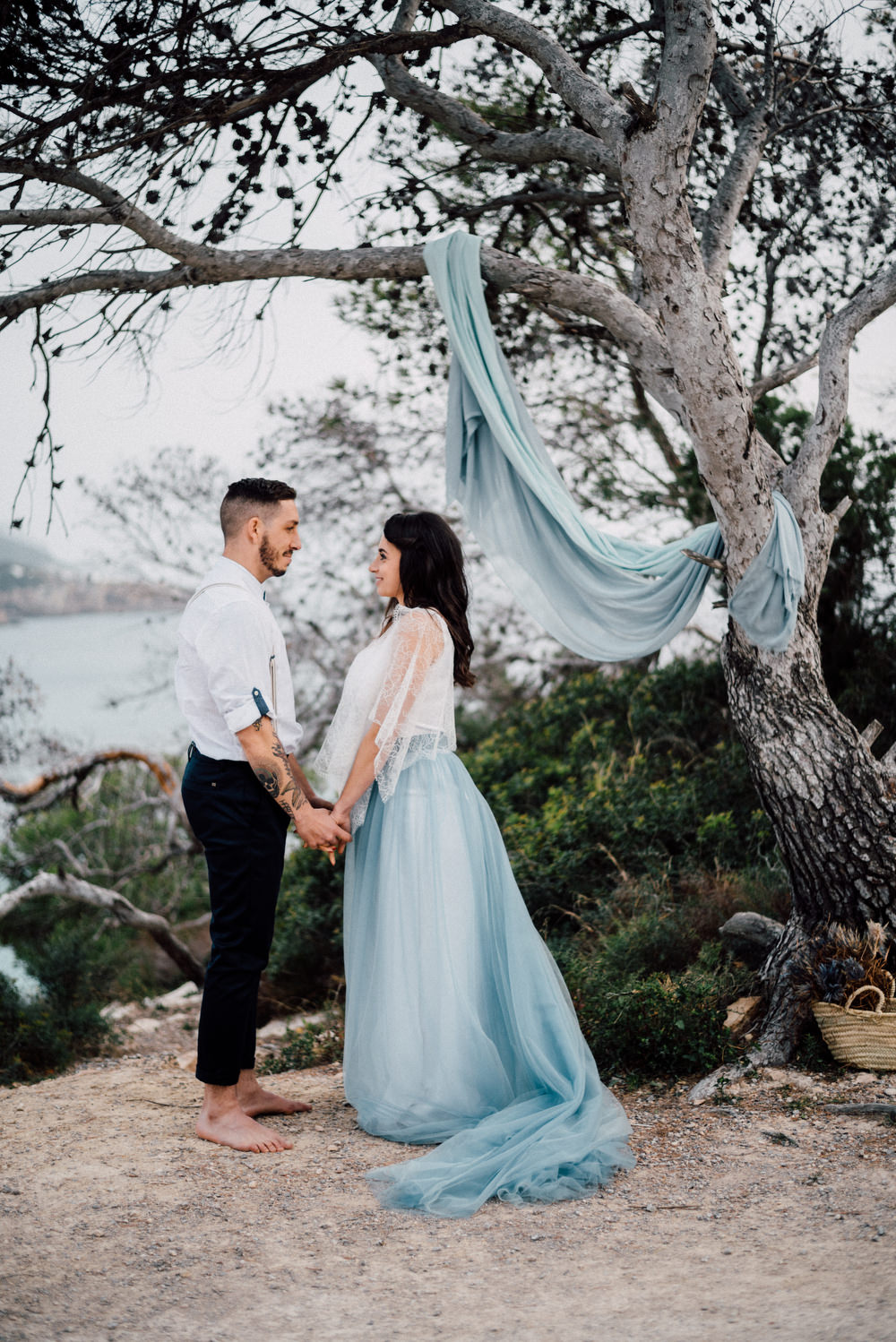 Outdoor Wild Nature Destination Spain Europe Sea Beach Styled Shoot Groom Braces Bride Blue Gown Lace Ceremony | Blue Ibiza Elopement Ideas and Surprise Proposal Serena Genovese Photography