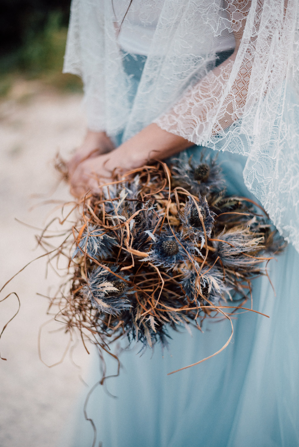 Outdoor Wild Nature Destination Spain Europe Sea Beach Styled Shoot Bride Blue Gown Lace Sea Holly Bouquet | Blue Ibiza Elopement Ideas and Surprise Proposal Serena Genovese Photography