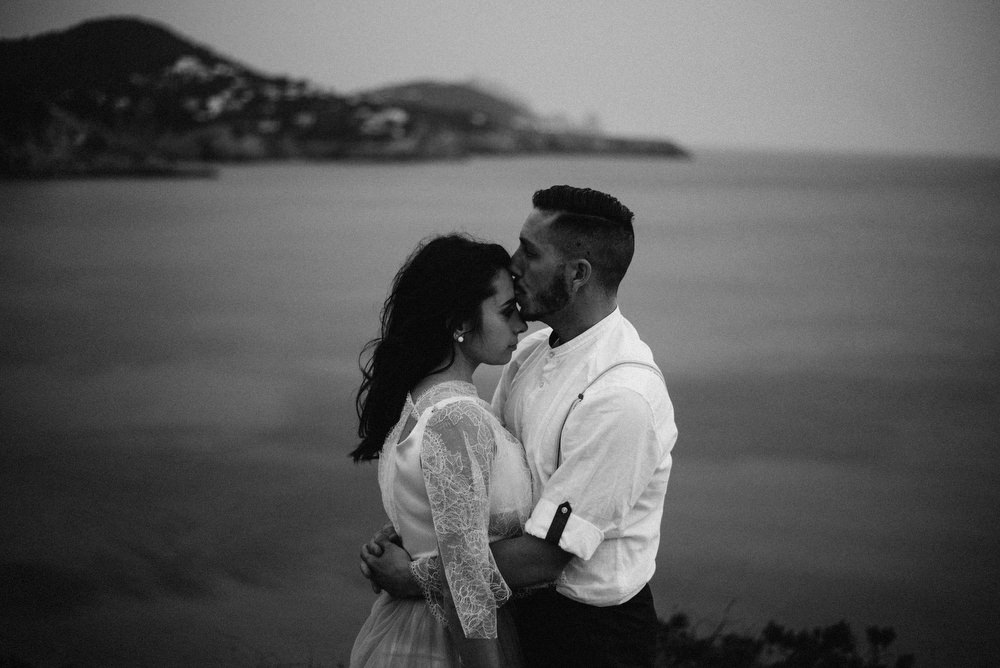Outdoor Wild Nature Destination Spain Europe Sea Beach Styled Shoot Groom Braces Bride Blue Gown Lace | Blue Ibiza Elopement Ideas and Surprise Proposal Serena Genovese Photography