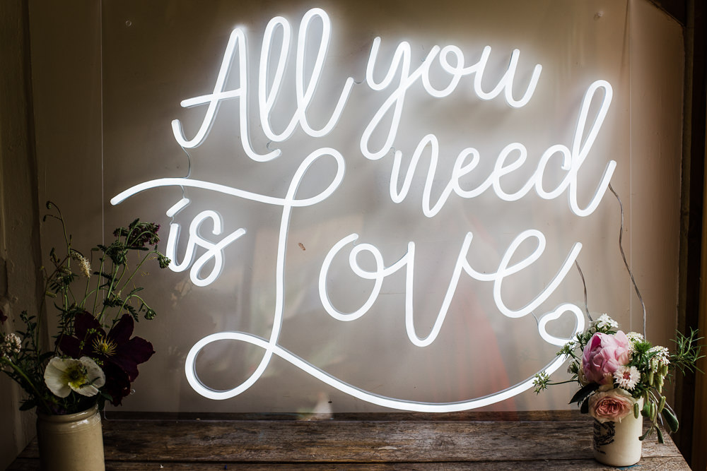 Neon Sign Love Quote Colourful Bohemian Floral Wedding Ideas Anna Beth Photography