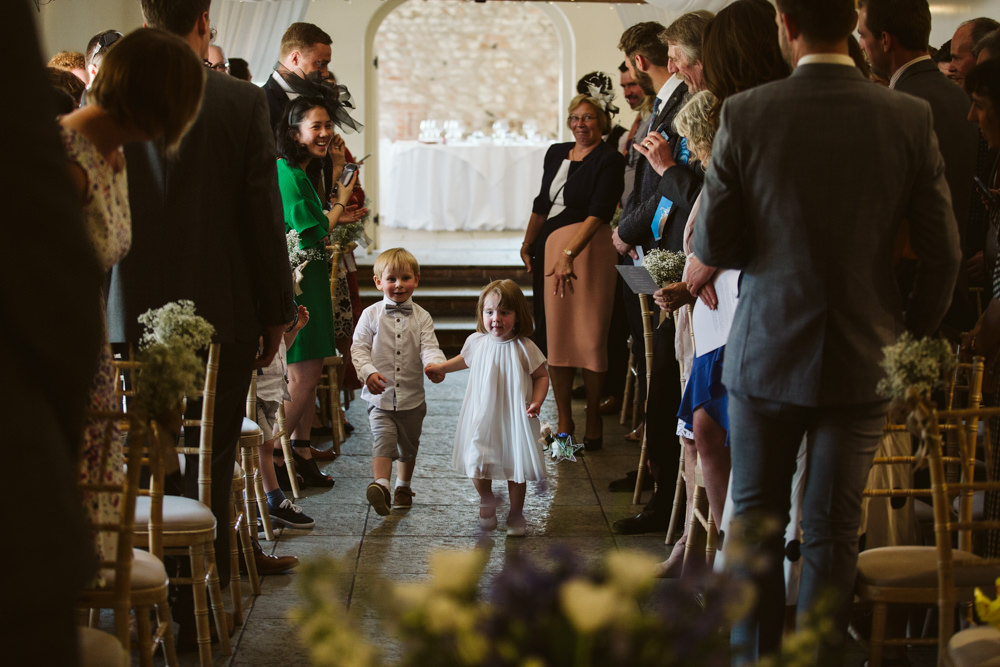 Travel Wine Inspired Rustic Outdoor Natural Farm Field Ceremony Aisle Flower Girl Paige Boy | Farbridge Barn Wedding Jamie Dunn Photography