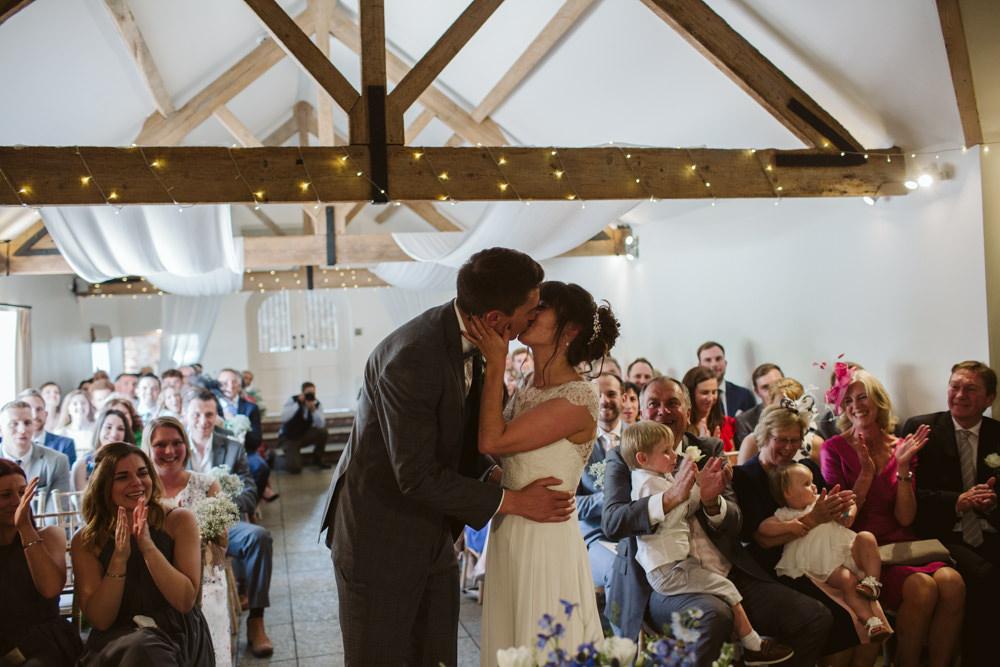 FTravel Wine Inspired Rustic Outdoor Natural Farm Field Bride Groom Kiss Ceremony Aisle | Farbridge Barn Wedding Jamie Dunn Photography