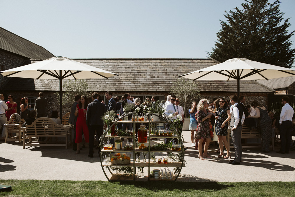 Travel Wine Inspired Rustic Outdoor Natural Farm Field Drinks Reception Circular Shelves Greenery | Farbridge Barn Wedding Jamie Dunn Photography