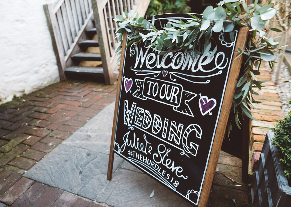 Chalk Black Board Welcome Sign Foliage Greenery George Rye Wedding Hollie Carlin Photography