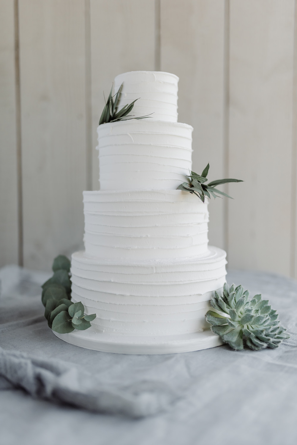 White Buttercream Iced Cake Foliage Succulents Grey Violet Wedding Ideas Chloe Ely Photography