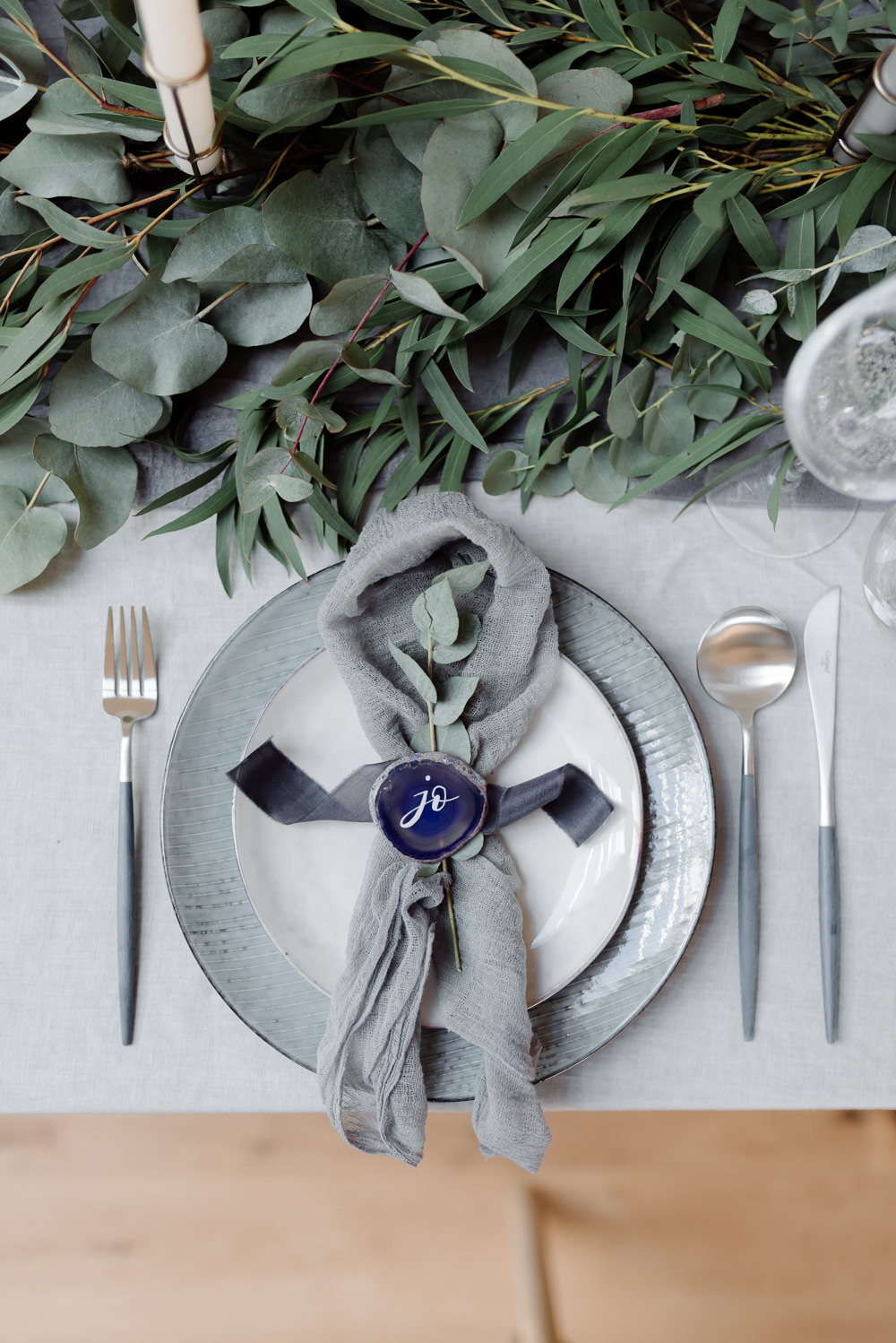 Agate Name Slice Calligraphy Place Setting Table Plates Cutlery Greenery Foliage Eucalyptus Ribbon Silk Napkin Grey Violet Wedding Ideas Chloe Ely Photography
