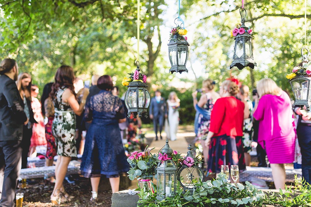 Hanging Lanterns Ceremony Table Flowers Hothorpe Hall Woodlands Wedding Lucy Long Photography