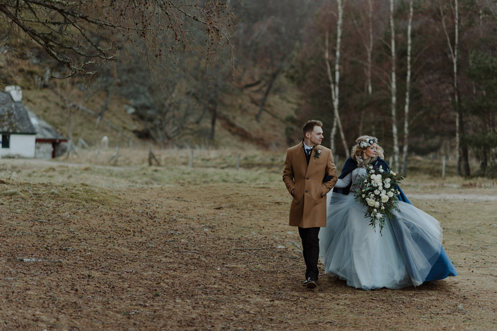 Forest Trees Castle Loch Bride Groom Blue Dress White Bouquet Floral Crown Cape Tan Coat | Intimate Winter Outdoor Scotland Wedding Christopher Ian Photography