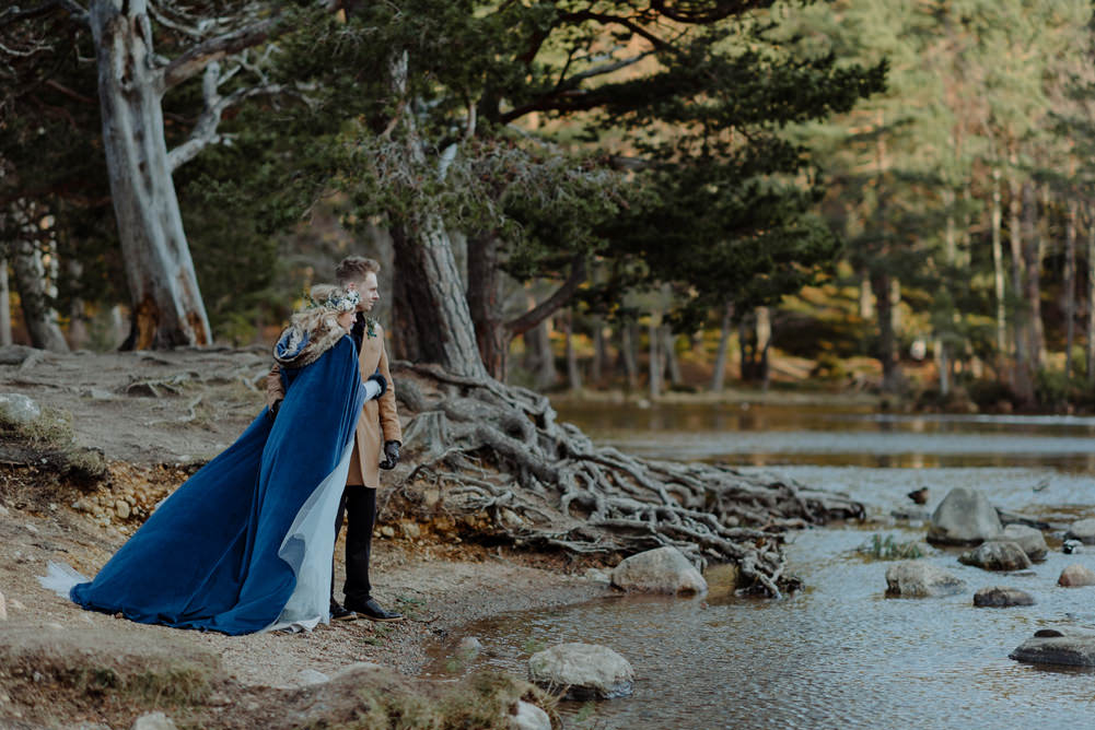 Forest Trees Castle Loch Bride Groom Blue Dress White Bouquet Floral Crown Cape Tan Coat   Intimate Winter Outdoor Scotland Wedding Christopher Ian Photography