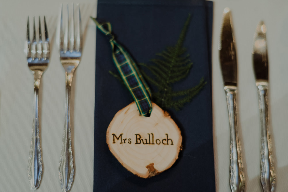 Forest Trees Castle Loch Simple Decor Greenery Fairy Lights Garland Runner Table Blue White Rustic Place Cards | Intimate Winter Outdoor Scotland Wedding Christopher Ian Photography