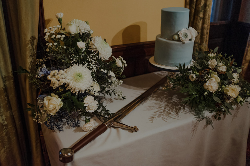 Forest Trees Castle Loch Simple Decor Greenery Fairy Lights Garland Runner Table Blue White Cake Sword   Intimate Winter Outdoor Scotland Wedding Christopher Ian Photography