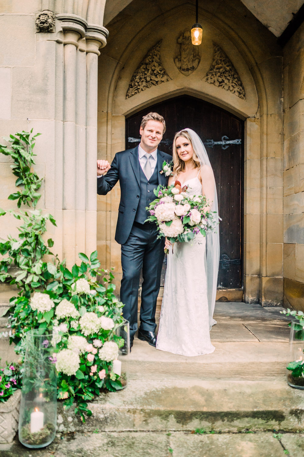 Church Entrance Flowers Hydrangea Rose Greenery Foliage Eucalyptus Arch Door Candles Pheasant Harome Wedding Yorkshire Arabella Smith Photography