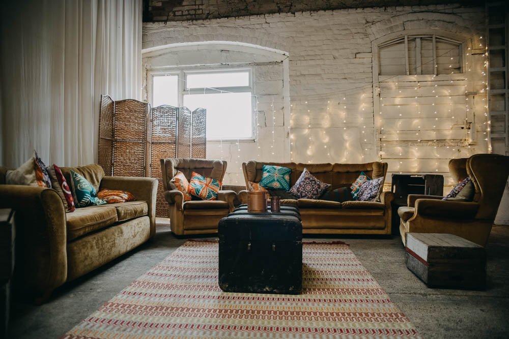 Relaxed Seating Area Occasional Rug Armchairs Vintage Railway Barn Wedding Lottie Photography