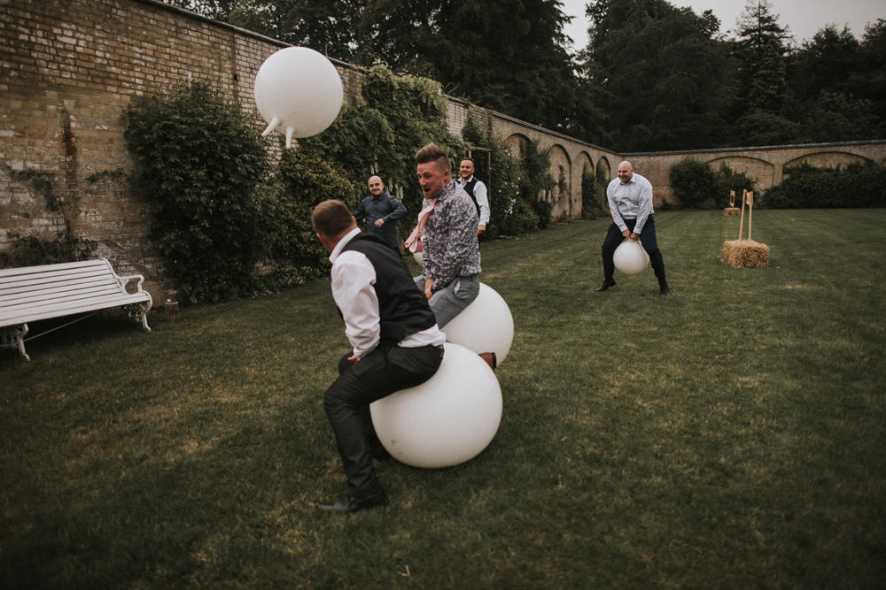 Outdoor Farm Field Wheat Rustic Garden Marquee Space Hopper Games | Fun and Relaxed Scrivelsby Walled Garden Wedding Brook Rose Photography