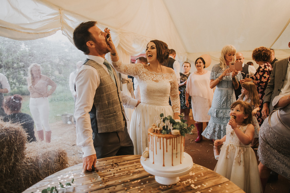 Outdoor Farm Field Wheat Rustic Garden Marquee Bride Groom Cake Cutting | Fun and Relaxed Scrivelsby Walled Garden Wedding Brook Rose Photography