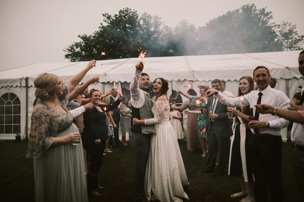 Outdoor Farm Field Wheat Rustic Garden Marquee Bride Groom Glitter Sparkler Tunnel | Fun and Relaxed Scrivelsby Walled Garden Wedding Brook Rose Photography