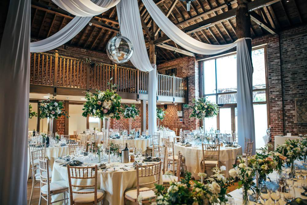 Tall Centrepiece Table Decor Flowers Greenery Foliage Drapes Disco Ball Barn Warm Welcoming Wedding Three Flowers Photography