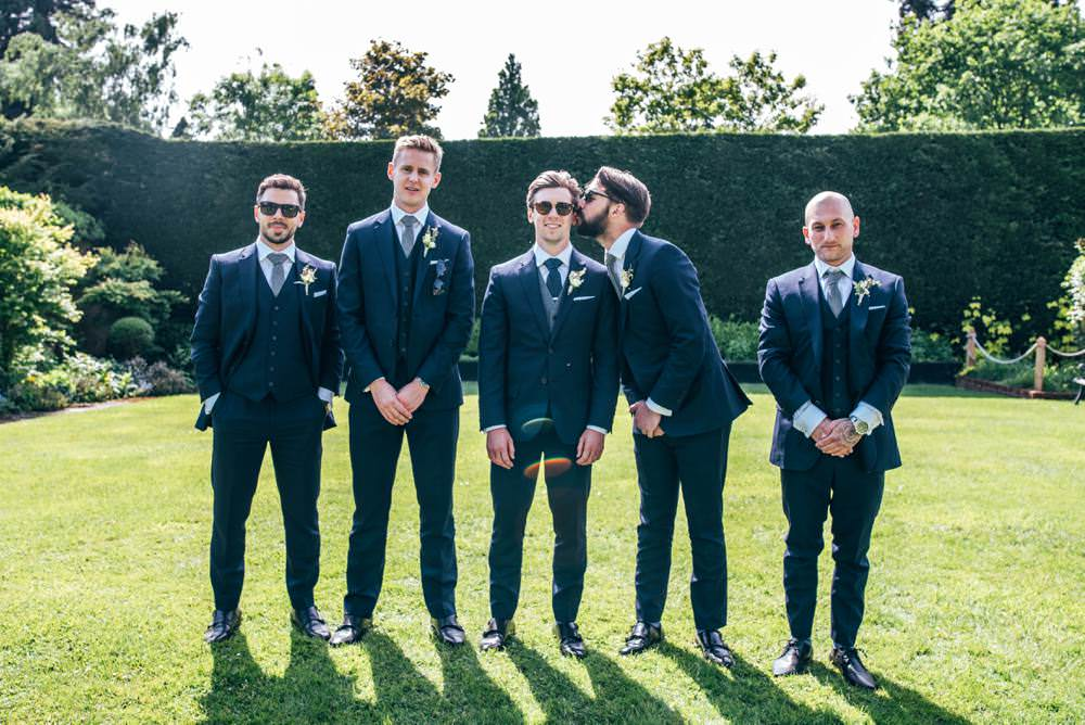 Groom Suit Navy Blue Groomsmen Polka Dot Tie Warm Welcoming Wedding Three Flowers Photography
