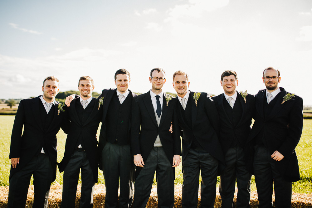 Groom Groomsmen Tails Morning Suit Whimsical Countryside Sperry Tent Wedding Emilie May Photography