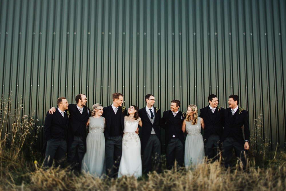 Bride Bridesmaids Groom Groomsmen Group Shot Whimsical Countryside Sperry Tent Wedding Emilie May Photography