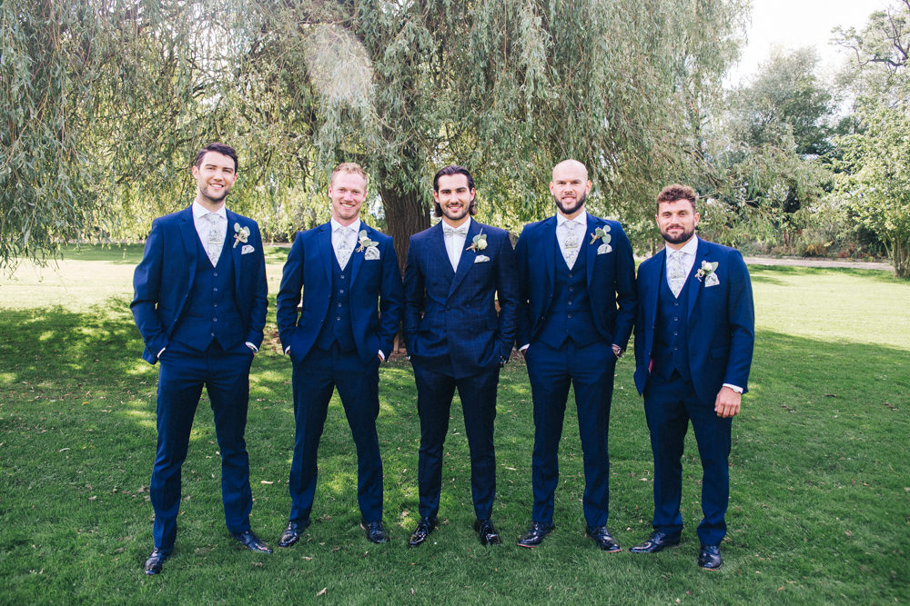 Groom Groomsmen Check Suits Navy Floral Bow Tie Wray's Barn Whinstone View Wedding Sally T Photography