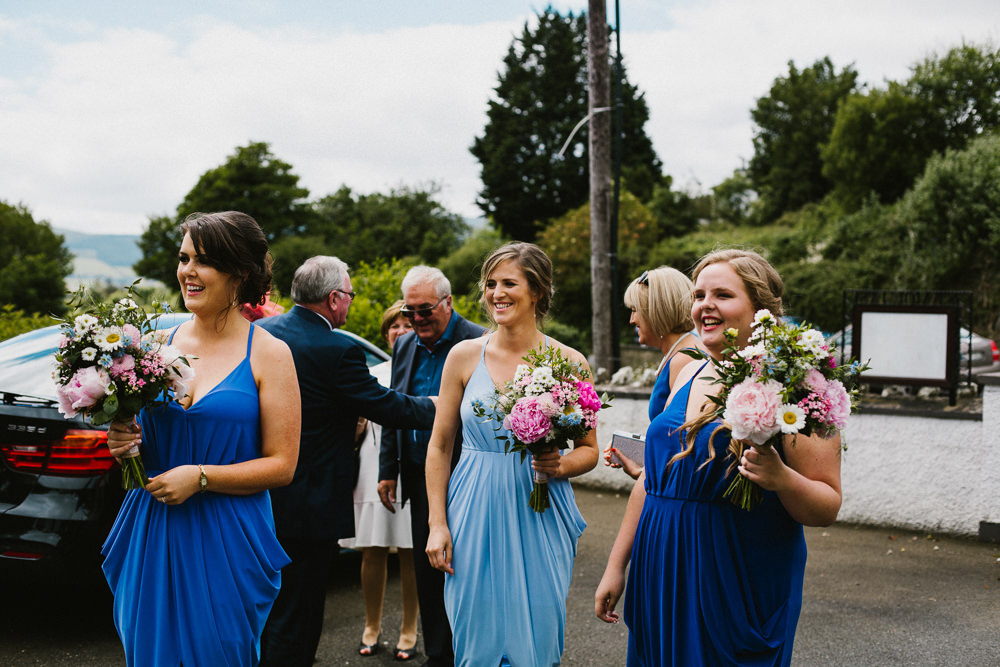 Blue Strappy Beach Bespoke Bridesmaids Dresses Multicoloured Bouquets Anna Carriga Wedding Honey and the Moon Photography