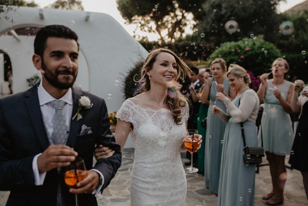 Bride Bridal Fishtail Lace Cap Sleeve Sweetheart Dress Gown Grey Suit Groom Aperol Bubbles Greece Destination Wedding Elena Popa Photography
