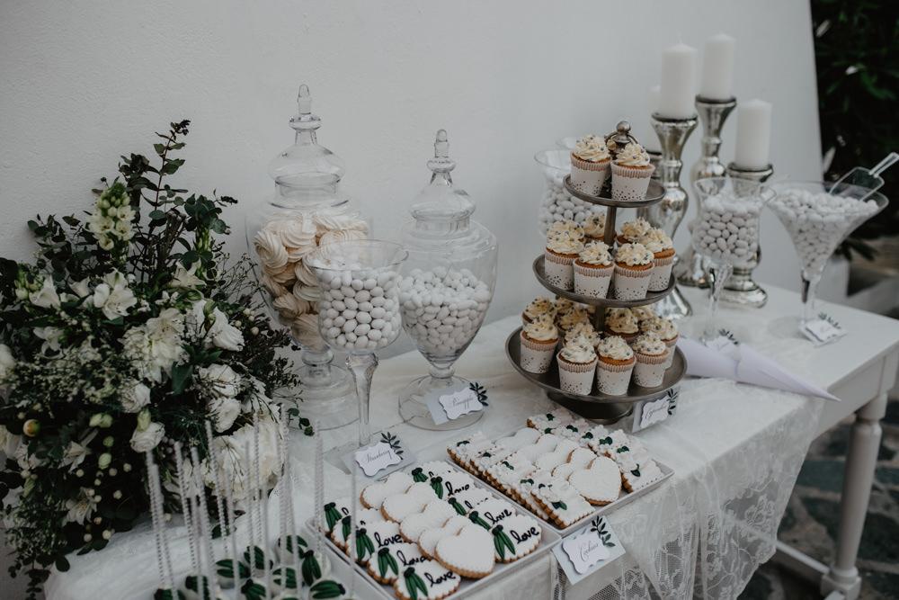 Dessert Cake Table Sugared Almonds Apothecary Jars Greece Destination Wedding Elena Popa Photography