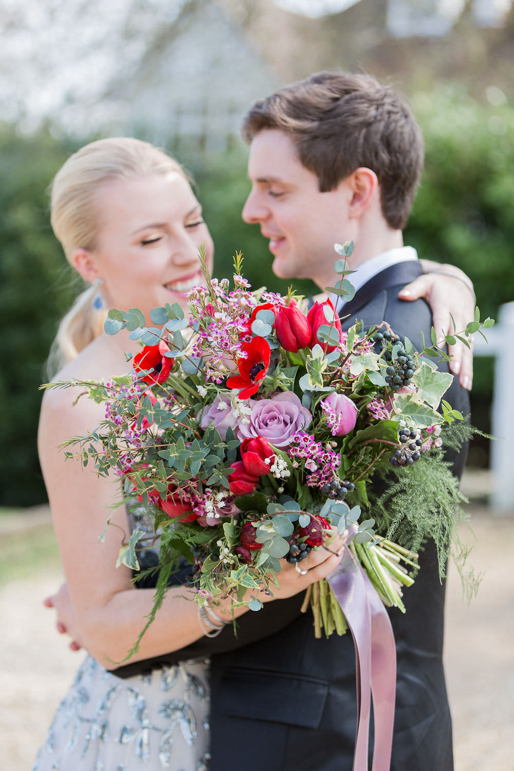 Bouquets Bride Bridal Bridesmaid Greenery Foliage Red Pink Rose Poppy Tulips Ribbons Highcliffe Castle Wedding Bowtie and Belle Photography
