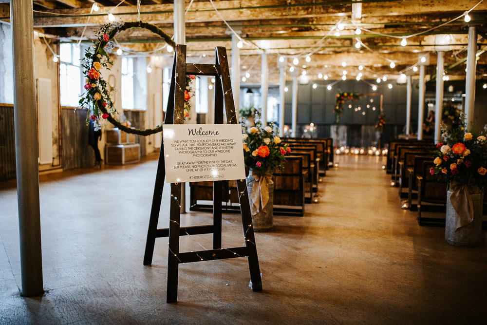 Ceremony Warehouse Industrial Easel Welcome Sign Holmes Mill Wedding Emilie May Photography