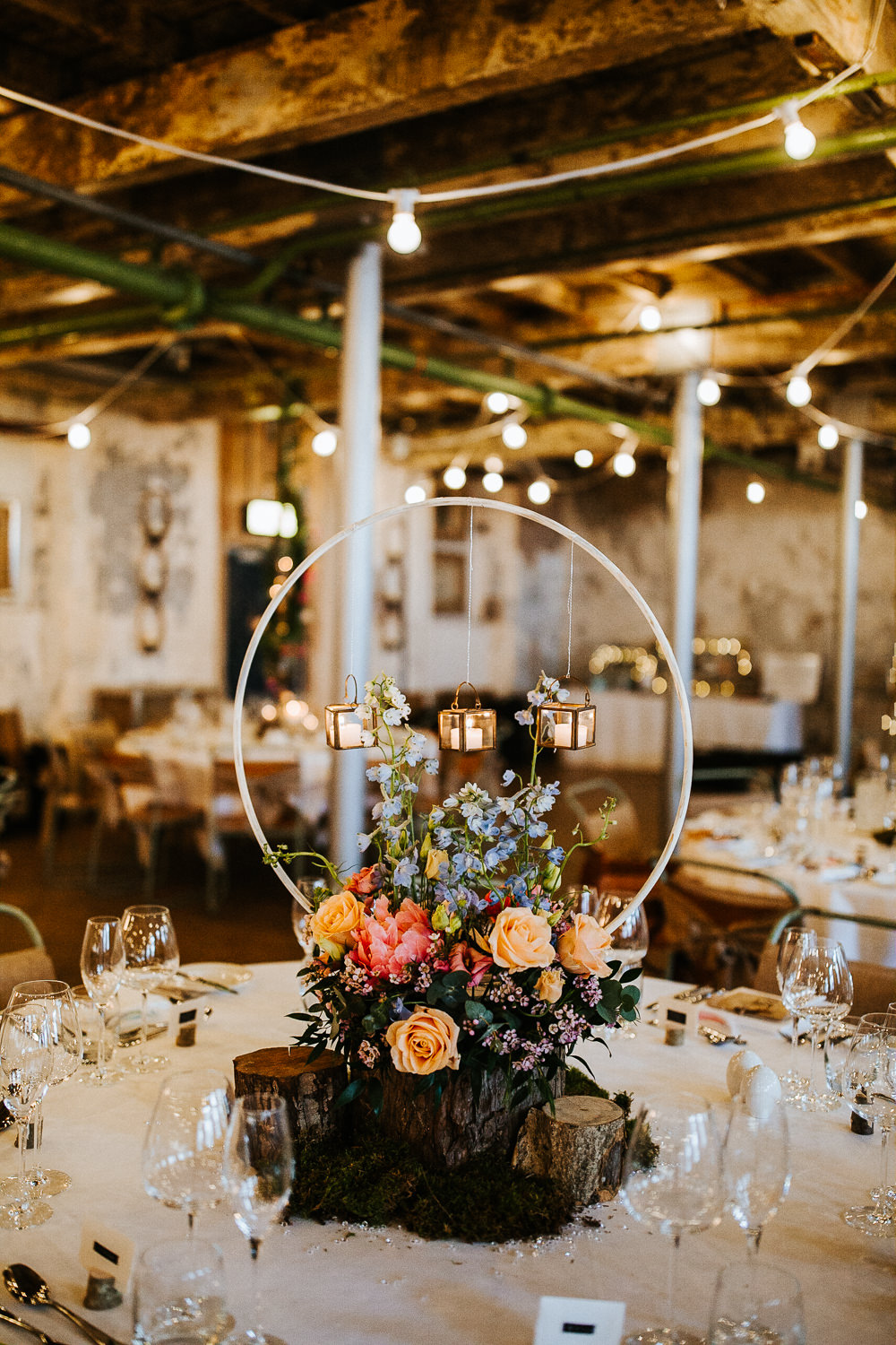 Centrepiece Hoop Circle Log Stand Flowers Moss Woodland Floral Peach Peony Coral Rose Candles Holmes Mill Wedding Emilie May Photography