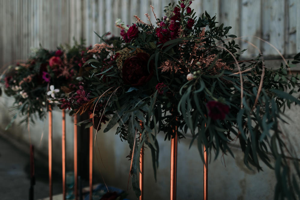 Suspended Hanging Flowers Table Decor Greenery Foliage Burgundy Industrial Luxe Wedding Ideas Balloon Installation Ayelle Photography