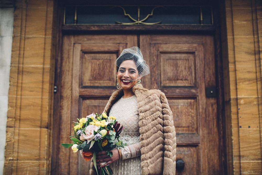 Bride Bridal Ivory Gold Indian Dress Embellished Long Sleeved Birdcage Veil Bouquet Fur Coat MC Motors Wedding LoveStruck Photography