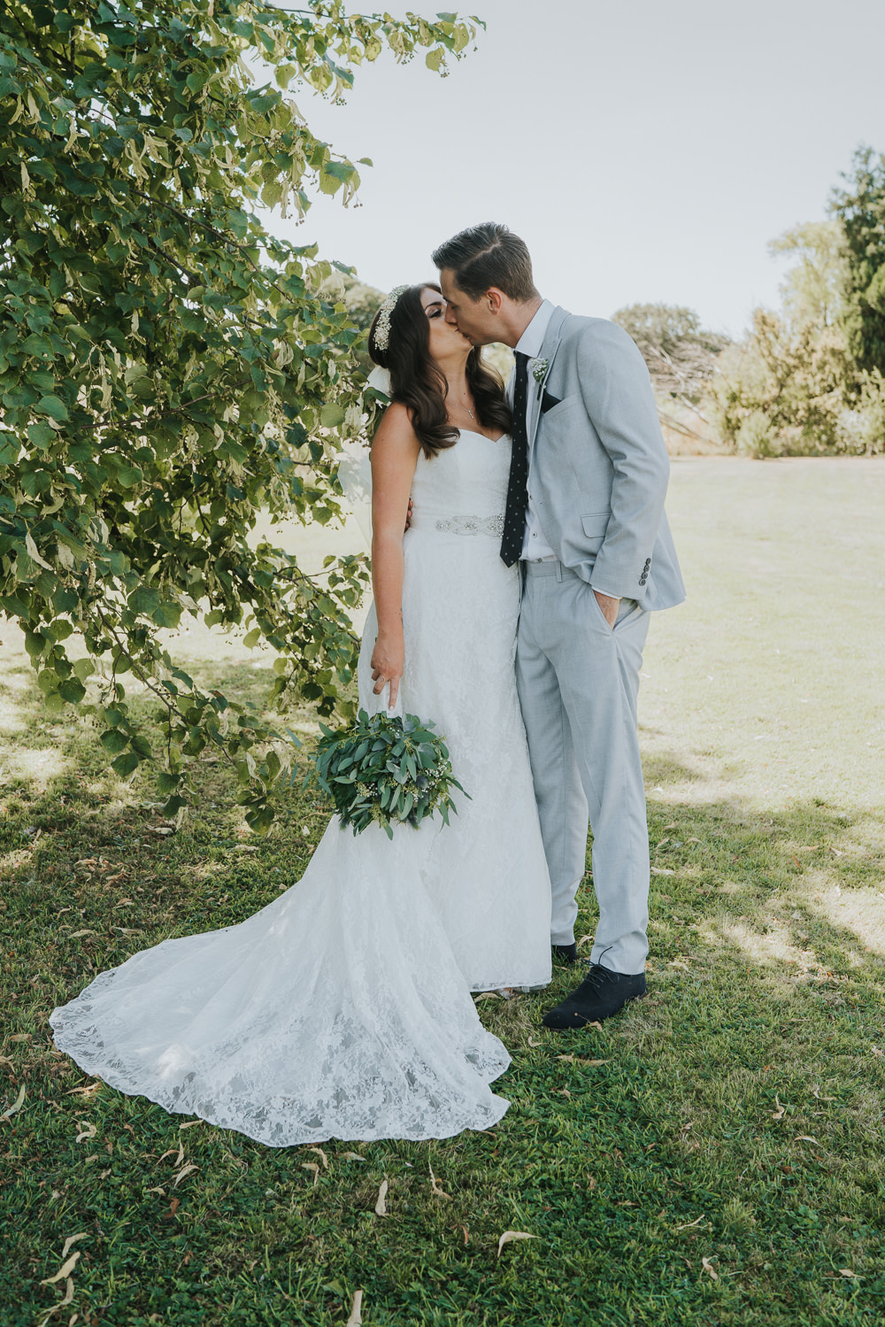 Intimate Outdoor Natural Relaxed Laid Back Summer Bride Groom Kiss Greenery Foliage Bouquet | Prested Hall Wedding Grace Elizabeth Photography