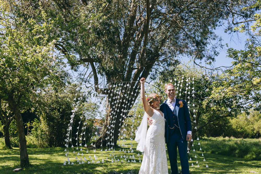 Paper Backdrop Garland Tree Ceremony Outdoor Rue De Seine Wedding Dress Bride Curious Rose Photography